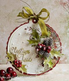hand crafted card/ornament by Dorota_mk ... shabby chic style .... bauble shape ... collage of real tiny pine cones, faux berries and shaped paper holly leaves ... ribbon and fibers ... pearls and sprayed snow ... wood lazer cut sentiment ... luv it!