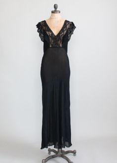 Vintage 1930s Black Crepe and Lace Nightgown $48.00 Sheer black crepe with fluttery black lace trim. The long skirt is bias cut and hugs the body beautifully. There is a tie bow back.