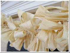 Corn husk garland  http://www.domestically-speaking.com/2010/09/countdown-to-fall-party-corn-husk.html
