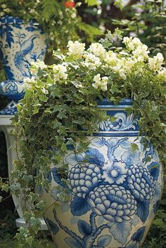 Our Blue and White Painted Tabletop Planter is an indulgence in ornate foliage, exotic birds and ceramic tile designed artistry.  | Frontgate: Live Beautifully Outdoors