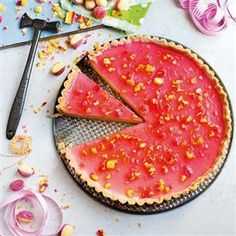 Boozy rhubarb and custard tart recipe. This creamy and crunchy dessert is made with rhubarb and custard sweets and rhubarb liqueur.