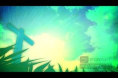 This Easter-theme worship video displays an image of the cross. The perspective--looking up at the cross--provides a beautiful view of the sky, with clouds moving by, and rays of light emanating from behind the cross. The scene is framed at the bottom by green blades of grass. #Sharefaith #Faith #ChurchMedia #VideoLoop #Design