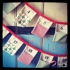 Christmas Advent Bunting. Colours - Red, Sage Green, Green, Aqua Blue and Cream. Patterns - Gingham, Spots, Christmas Trees and Stars.. £45.00, via Etsy.