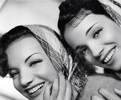 "Carmen & Aurora Miranda. Carmen Miranda was nicknamed ""The Brazilian Bombshell"" noted for her signature fruit hat outfit, by 1945, she was the highest paid woman in the United States. Her sister Aurora appeared in several films & in 1934 recorded a song about the ""marvellous city"" of Rio de Janeiro, ""the heart of my Brasil""."