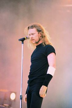 James Hetfield, recovering from a terrible stage pyrotechnics accident (8/8/92, Montreal) that burned (2nd and 3rd degree) his left hand and forearm, plus the side of his face and hair.