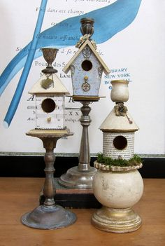 craftstore birdhouses mounted on candlesticks.  add embellishments and paint it all white for indoor bird decor