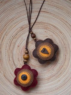 Felt flowers bookmark. make nice necklaces as well.