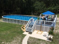 Pool Deck Ideas (Partial Deck) - The Pool Factory Rectangle Above Ground Pool, Oval Above Ground Pools, Best Above Ground Pool, Rectangle Pool, In Ground Pools, Above Ground Pool Landscaping, Backyard Pool Landscaping, Backyard Pool Designs, Deck Ideas For Above Ground Swimming Pools
