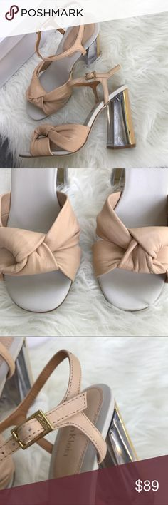 NEW Calvin Klein Loreen Nude Block Heel Sandal 7 So sophisticated and perfectly on trend! Blush-nude knotted leather detail at the toe. Block heel is wood grain and clear lucite. Ankle buckle. Size 7. Comes in original box. Offers welcome, no trades. Calvin Klein Shoes Sandals