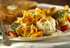 Colorful red bell pepper brightens the mix of broccoli and cauliflower in this creamy casserole.