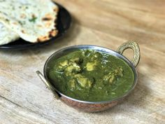 Chicken is simmered in a creamy spinach sauce, a delicious north Indian favorite. A step-by-step recipe for the Instant Pot or Pressure Cooker.