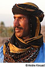 Berber Man Watching the Sunset at the Oasis, Skoura, Morocco [© Airdrie Kincaid]