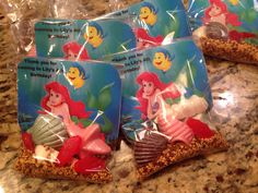 I decided to do my own non toy version of a goody bag for a Little Mermaid party. I just used candy melts and sea shell molds to make the chocolates, I threw some Swedish fish in there, for the sand I used Wilton Turtle Crunch sprinkles and I used some classic pearl gems in there just for fun. I printed out the background and personalized it on my computer and I thing they turned out perfect. Enjoy!