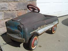 Old pedal car....mine was red