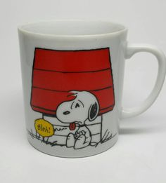 1965 Snoopy Mug © United Feature Syndicate, Inc. Made in Japan    One side shows Snoopy saying Bleh! while sitting outside his dog house.    Other