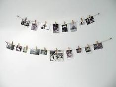 DIY #2 photo hanger materials: -rope {1} -clips {a lot} -photo How: -first tie the rope to a 2 hangers. ( i use my bed) -take some clips and photo's then clip the photo's to the rope Hope This Help...