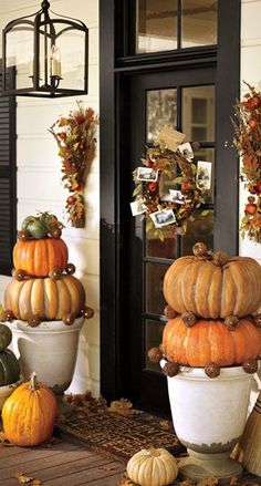 SUZ:  Do a pumpkin painting for front door.  Now.    15 Thanksgiving Front Porch Decorating Ideas | Shelterness