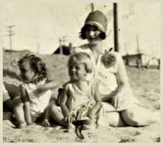 Norma Jeane Baker __ what a CUTE smile! ;-) . .. w/her mom & sister.
