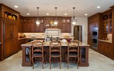 The owners of this meticulously maintained Long Island home wanted us to create a dream kitchen design for their Great Neck, Gold Coast estate in dark wood.