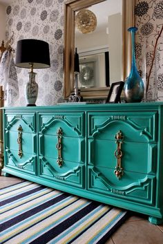 Beautiful Green 9 Drawer Dresser with Gold Hardware Re-tiqued By Rae Bond.