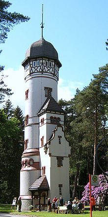 Water tower of the Ohlsdorf cemetery (with a bus stop), Hamburg, Germany. Established in 1877, it has over 280,000 graves, and 1.5 million interments.