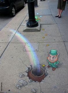 By David Zinn. His artwork pops up all over Ann Arbor, Mi.