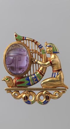 Brooch, by Theodore B. Starr (American, New Rochelle, New York 1837–1907 Ridgefield, Connecticut), ca. 1900, gold, amethyst, demantoid garnet, and enamel, 1 1/4 × 1 1/8 in. (3.2 × 2.9 cm)