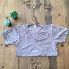Neutral Natural T-Shirt ❤️American Apparel❤️ This is a super soft tee that has been loved. V neck with some color fade. Take advantage of bundling!  American Apparel Tops Tees - Short Sleeve