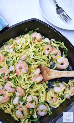 Shrimp Scampi Zoodles   by Life Tastes Good is a lower carb version of a traditional Shrimp Scampi recipe typically served over pasta. This recipe still has all the fresh tasting garlic and buttery goodness of the traditional recipe, but is served over zucchini noodles, or the more fun way of saying it 'zoodles', to get rid of all those carbs from the pasta. Just for the record... I didn't miss the pasta at all! #zoodles #zucchinirecipes #healthyrecipes #seafoodrecipes