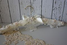 https://flic.kr/s/aHsktZhpEj | Wedding Dress Hangers | Don't leave your wedding dress hanging from a dowdy plastic or wooden hanger - please!  Give it the display it deserves on this gorgeous padded satin hanger with Turkish lace apron, delicate rosettes, pearls and diamante details.