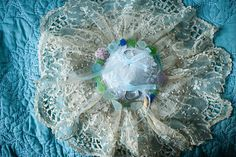 Ring pillow with sea glass made by my mother. Photo from Krista and Jonathan collection by Dan Speicher Photographers