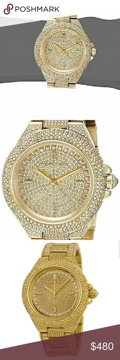 ***Michael Kors Crystal Encrusted Gold watch*** Hundreds of sparkling gold crystals are encrusted along every surface of this beautiful Michael Kors watch. Crafted of durable stainless steel, this eye-catching watch is the perfect choice for any one who wants to make a statement. Sure to turn heads. Crystal-covered watch featuring logoed dial with four stick indices 43 mm gold-tone stainless steel case with mineral dial window Quartz movement with analog display Gold-tone stainless steel…
