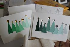 paint match cards made into triangle trees with rhinestone topper