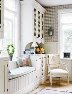 Love the whole thing - from the window seat to the built-in hutches to the wainscoting & pretty window trim.