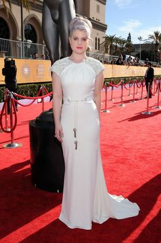 Kelly Osbourne chose a white Badgley Mischka gown with quirky detailed sleeves for the red carpet at 2012 SAG awards