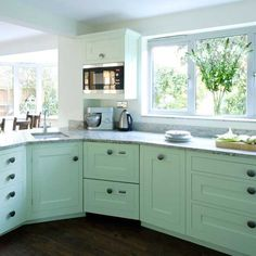 Lovely kitchen. I like the robin's egg cabinets and the knobs.