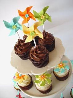 Cupcakes with fondant pinwheel toppers. Fun.