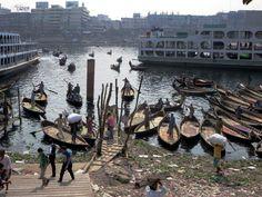 Rowboats crossing the Buriganga River at Dhaka, Bangladesh, depart from Sadarghat. Gypsum Decoration, Gypsum Wall, Dhaka Bangladesh, Ceiling Rose, River, Rivers