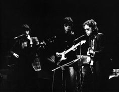 Bob Dylan performs live on stage with Rick Danko and Robbie Robertson of The Band at Madison Square Garden New York