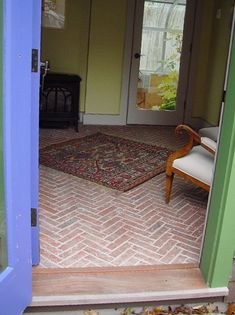 Entryways and hallways - Inglenook Brick Tiles - thin brick flooring, brick pavers, ceramic brick tiles I like the scale, chevron pattern and color of these. I think it has a warm, well-textured appearance for an entryway. Brick Tile Floor, Brick Paving, Brick Porch, Porch Wood, Foyer Flooring, Brick Flooring, Tiled Hallway, Doors And Floors, Porch Addition