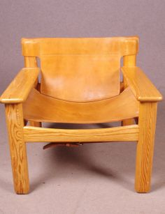 YNGVE EKSTRÖM Swedish design Armchair in oiled solid pine and patinated cognac colored leather.