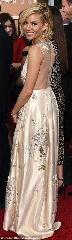Her big day! Sienna Miller wore a wedding-worthy Miu Miu gown, complete with hand embellishment