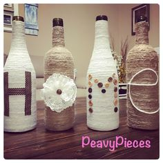 Twine HOME wine bottles, upcycled wine bottles, house warming gift, twin, jute, wine, vase, wine bottle decor, centerpiece, farmhouse decor by PeavyPieces on Etsy https://www.etsy.com/listing/238083795/twine-home-wine-bottles-upcycled-wine