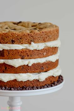 Thick layers of chocolate chip cookies are stacked with vanilla buttercream to create a delicious chocolate chip cookie layer cake! Adorable and SO. YUM.