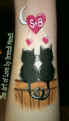 Two cats in love face painting. Initials to personalize your design for the customer.