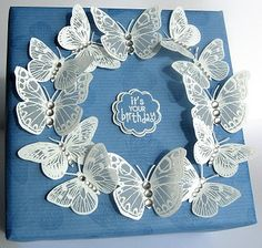 White embossed vellum butterflies (try colouring spots with Copics)