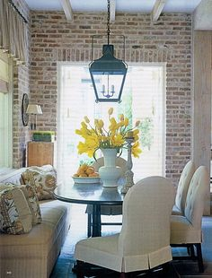 Interesting combination with the brick wall, beams above and lantern pendant light ~ I think I like it!