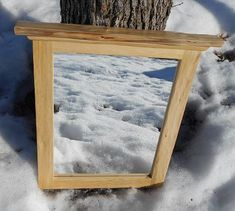 This rustic Cedar framed mirror is made of Northern White Cedar cut from northwestern Wisconsin. The face and top of the frame have been hand scorped to give the frame a very unique and beautiful contoured profile. The entire frame has been sanded enough to make the frame smooth, but also keeping the profile that was purposefully created. The frame has been sprayed with three coats of water-based polyurethane to seal the wood and protect it.