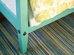 A fresh, modern take on coastal decor, traditional pencil-post beds are painted a vibrant shade of turquoise.