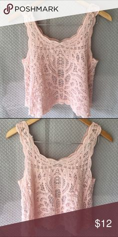 Pretty pink top from Charlotte Russe Light pink lace top from Charlotte Russe, worn a couple times and in excellent condition.  Size XS but could fit a small also. Charlotte Russe Tops Tank Tops